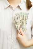 Woman with dollar bills in hand Royalty Free Stock Images