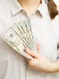 Woman with dollar bills in hand Stock Photos