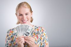 Woman with dollar bills Stock Images
