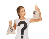 Woman with dollar and euro signed bags Stock Photos