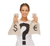 Woman with dollar and euro signed bags Stock Images