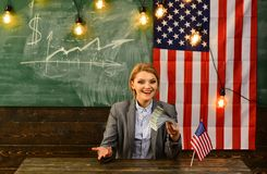 Woman with dollar money for bribe. Income planning of budget increase policy. Independence day of usa. American. Education reform at school in july 4th. Economy royalty free stock image