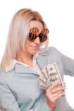 Woman with Dollar sign glasses and Dollar bills Stock Photography