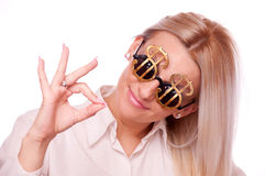 Woman with Dollar sign sunglasses, showing thumbs up Stock Images
