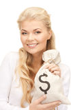 Woman with dollar signed bag Stock Photos