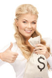 Woman with dollar signed bag Stock Image