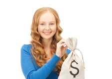 Woman with dollar signed bag Stock Images