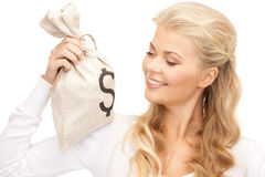 Woman with dollar signed bag Royalty Free Stock Image