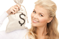 Woman with dollar signed bag Royalty Free Stock Photography