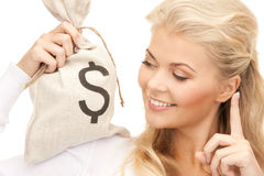 Woman with dollar signed bag Royalty Free Stock Photos