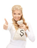 Woman with dollar signed bag Stock Photography