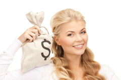 Woman with dollar signed bag Royalty Free Stock Images