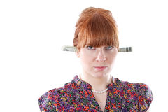 Woman with dollars in ears Royalty Free Stock Image