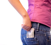 Woman with Dollars in her pocket Royalty Free Stock Photos