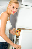 Woman at domestic kitchen stock images