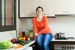 Woman in domestic kitchen Royalty Free Stock Photo