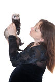 Woman with a domestic polecat Royalty Free Stock Photo