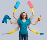 Woman in a domestic role multitasking her cleaning Stock Photos
