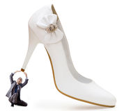 Woman domination concept - shoes and man Royalty Free Stock Image
