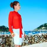 Woman in Donostia; San Sebastian, Spain looking into distance. Luxury weekend retreat. Full length portrait of pensive stylish woman in red blouse standing in royalty free stock photos