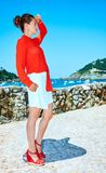Woman in Donostia; San Sebastian, Spain looking into distance. Luxury weekend retreat. Full length portrait of stylish woman in red blouse standing in front of Royalty Free Stock Photo