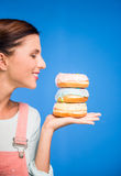 Woman with donuts. Royalty Free Stock Photo