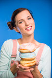 Woman with donuts. Stock Image