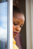 Woman at a door Royalty Free Stock Image
