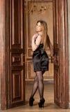 Woman at the door. Beautiful young woman in a dress at the door Stock Photos