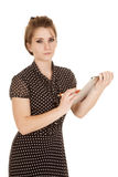 Woman dot dress stand clipboard look serious Stock Photos