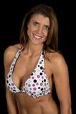 Woman dots on bikini on black facing slight angle Stock Photo