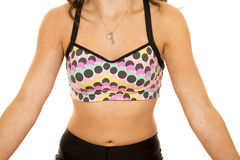 Woman dots on sports bra close stomach Royalty Free Stock Photos