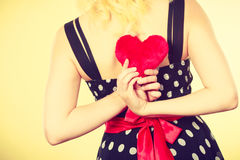 Woman in dotted dress holding red heart Stock Photos