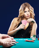 Woman doubt in a card gambling match Royalty Free Stock Photography