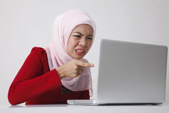 Woman doubt with computer Stock Photography