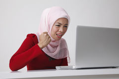 Woman doubt with computer Stock Images