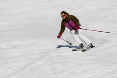 Woman downhill skiing royalty free stock photography