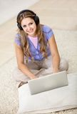 Woman downloading music Stock Photo