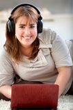 Woman downloading music Stock Photography