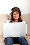 Woman downloading music Royalty Free Stock Photos