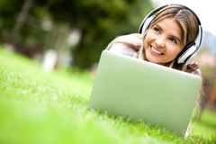 Woman downloading music Stock Photos