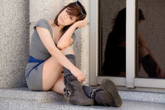 Woman Downtown in Dress and Boots Stock Image
