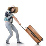 Woman drag a luggage Stock Photography