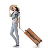 Woman drag a luggage Stock Images