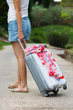 Woman dragging a suitcase Royalty Free Stock Photo