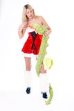 Woman with dragon. Beautiful blonde christmas woman posing with dragon wearing red dress and white fluffy gaiters  on white background Stock Photos