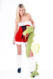 Woman with dragon. Beautiful blonde christmas woman posing with dragon wearing red dress and white fluffy gaiters  on white background Royalty Free Stock Photo