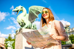 Woman with Dragon statue in Ljubljana city Royalty Free Stock Images