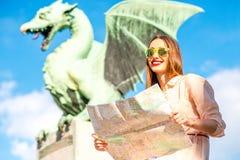 Woman with Dragon statue in Ljubljana city Royalty Free Stock Photo