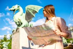 Woman with Dragon statue in Ljubljana city Stock Photos